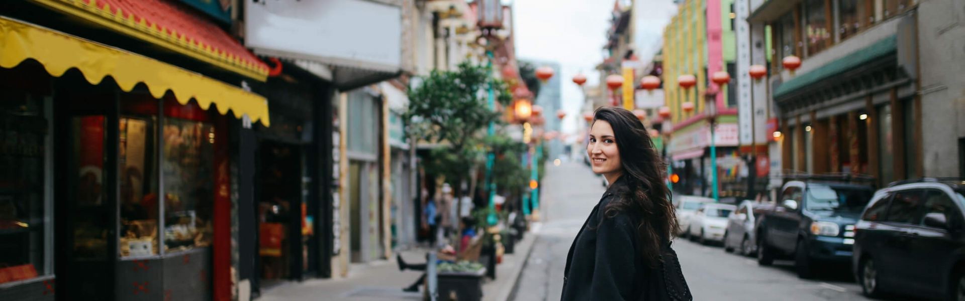 woman walking around chinatown in san francisco