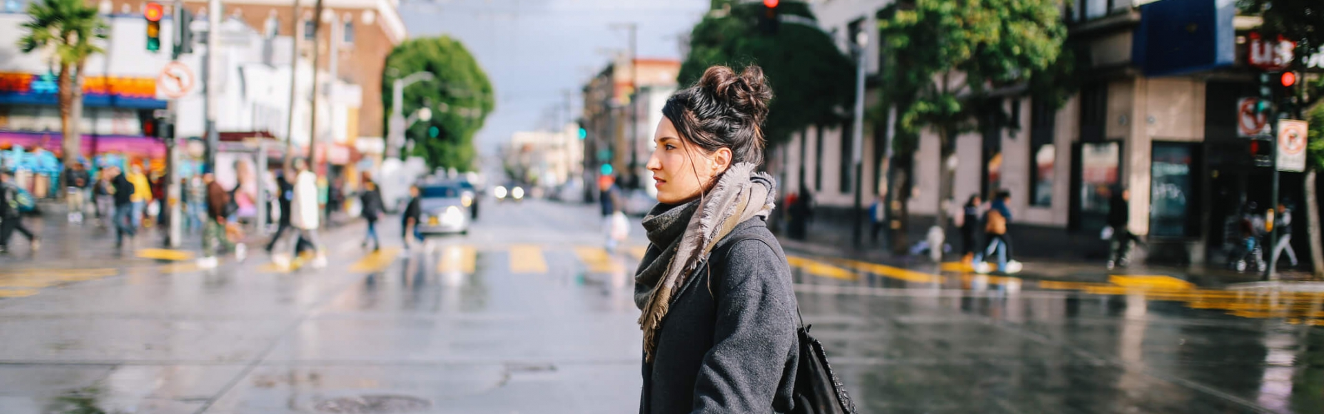 woman walks across the street in san francisco neighborhood