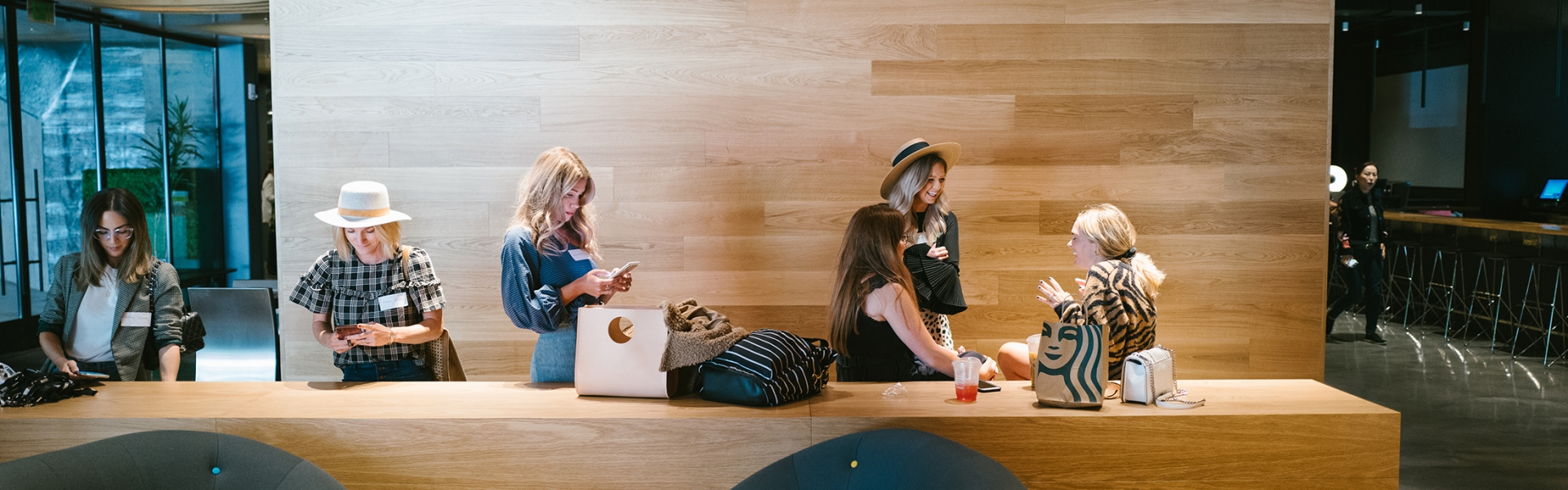 group of women gather in lobby to chat and work