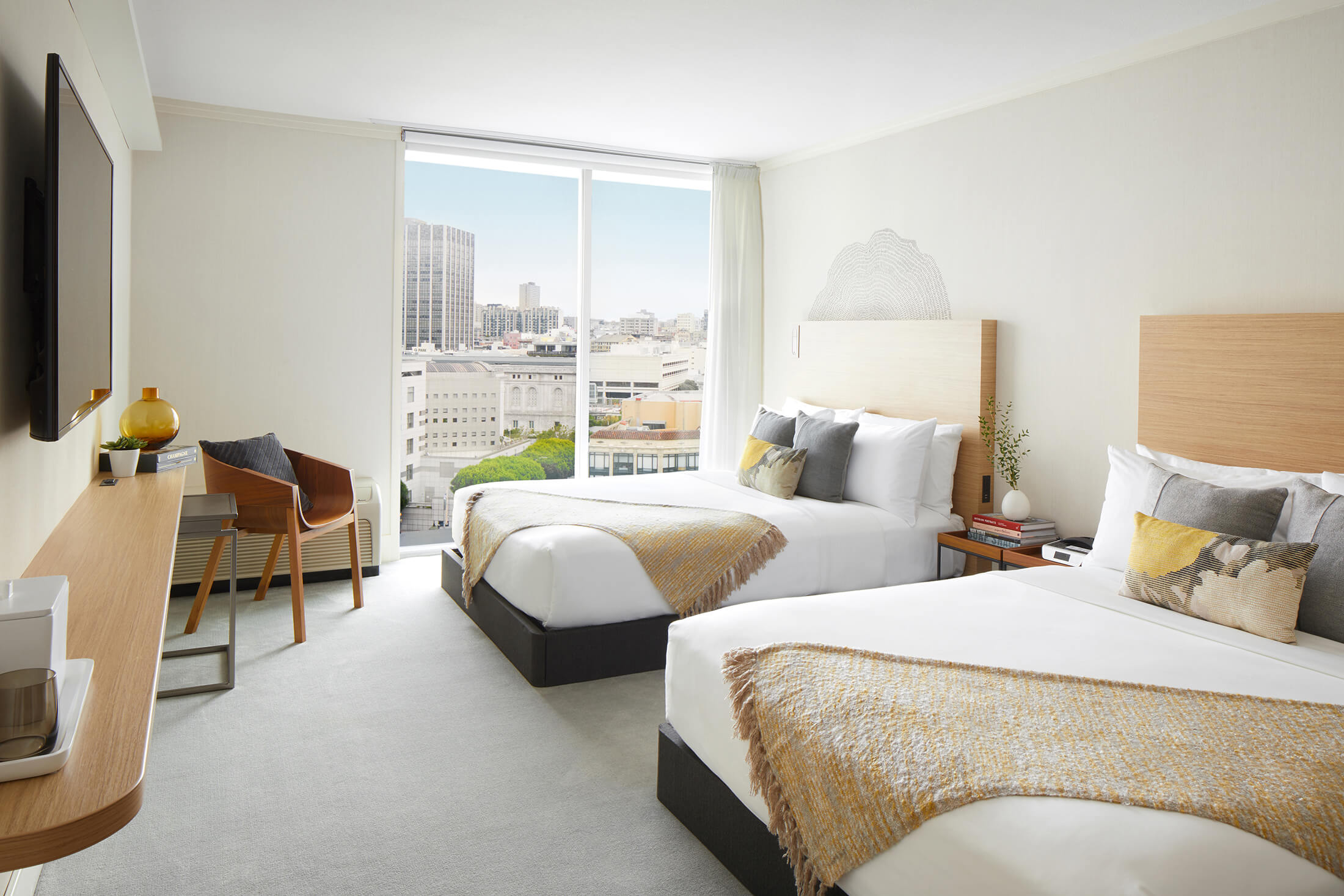 bei superior room featuring two beds and a city view