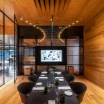 boardroom with wooden walls and ceiling, complete with stylized chandelier