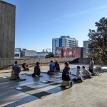 group gather for yoga session on the bei terrace