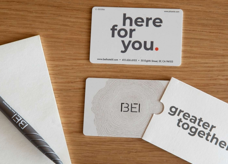 Here for you card and pen on table